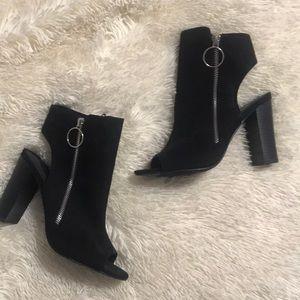 Black heeled zip up booties